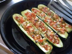 Stuffed Zucchini with tomatoes,onions, and cheese  (I baked mine and added in mushrooms) Yum! About 3-4 net carbs per serving.