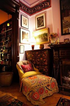 the perfect napping chair: tucked into the corner of a room, right near a bunch of books and covered with a pretty quilt.