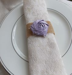 Napkin Rings Burlap and Flower Rustic Shabby Chic Wedding Decor. $1.50, via Etsy.