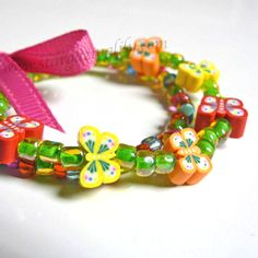 Chasing Butterflies in the Grass Girls Bracelet Red Orange Yellow & Green Bright and Colorful with a Pink Bow Easter Basket Filler