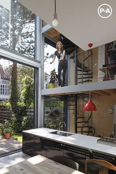 woning Joyce & Jeroen in Den Haag.  wrap a mezzanine balcony around the existing atrium, looking down on the garden/light box below, bringing exterior into the apartments (internal balcony instead of street facing balconies)
