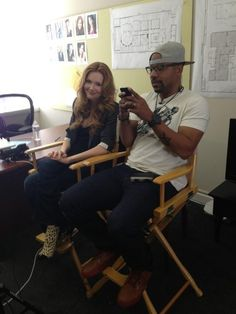 Darby Stanchfield and Columbus Short Just chillin...except that those shoes are HOT!