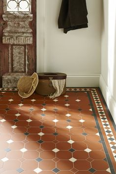Harrogate is shown here in a warm palette, adding a rustic charm to this hallway. This pattern will make a statement in hallways, living rooms, bathrooms, kitchens - wherever it is used! New colours, patterns and shapes means our geometric Victorian style floor tiles look great in traditional and contemporary homes. originalstyle.com