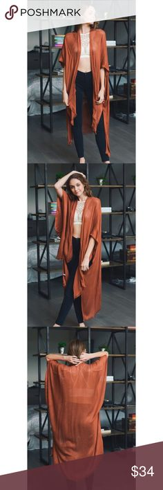 """🆕Sweet Splendor Kimono - Rust Keep the groove in your heart with the Sweet Splendor Kimono! Perfectly lightweight as it forms an open front kimono with frayed trim with armholes, and an extra long bodice with side slits. Available in Black and Blush. 100% Viscose. Size: 43""""x42"""" High Low Kimono . . . If you would like to make an offer, please use the OFFER BUTTON. {10% discount on all 2+ orders} . . FOLLOW US✌🏽️ Insta 📸: shop.likenarly Facebook📱: likenarly Website 🌐: likeNarly.com…"""