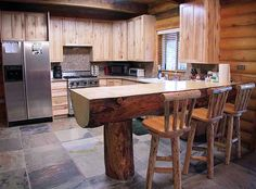 Kitchen countertop / island made from tree log, plus XL tile flooring!