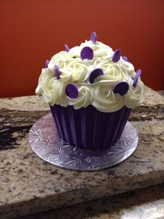 Giant cupcake purple and white with sprinkles