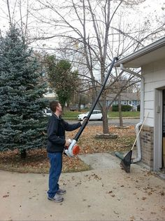 Use pvc pipe with leaf blower to get leaves out of gutters without using a ladder