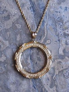 this makes me smile so hard: stargate necklace! Probably the only way I could wear an open circle necklace