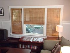Screw curtains that are too short...I'm just gonna rattan-blind my living room windows like this.