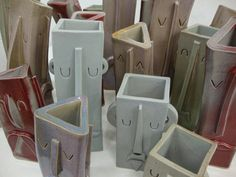 For my momma - Slab ceramic face vessels. Notice the molds were forms other than a cylinder.