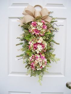 Can you imagine this swag on your front door to welcome family and friends? 12+ COLOR CHOICES to match with your house colors or choose for any season/holiday. Swags are the latest trend in decorating as are hydrangea flowers. A beautiful combination for an inviting first impression. COLOR CHOICES: https://www.etsy.com/shop/timelesshomedecor?ref=listing-shop2-all-items-count&section_id=19316568…