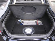 Back in 2007, even though we had only been open a short time, the owner of this Jaguar XK trusted the team at California Custom Sounds to upgrade their audio system! So we fabricated a custom ported enclosure to house a Diamond Audio subwoofer, in the spare tire well, and we built a new steel mesh-reinforced trunk panel, to protect the sub and port. To provide power to the system, a pair of stacked Diamond Audio amps were installed.