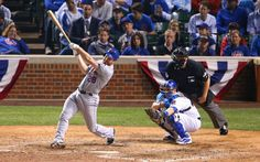 Oct 21, 2015; Chicago, IL, USA; New York Mets second baseman Daniel Murphy hits a two-run home run against the Chicago Cubs in the 8th inning in game four of the NLCS at Wrigley Field.