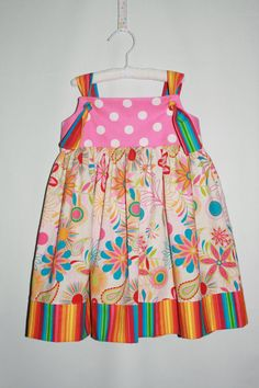I am so excited for summer and cute sun dresses!!!!  Summer Fun Knot Dress by kiddobadiddo on Etsy, $25.00