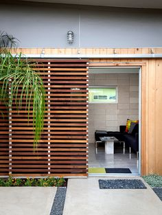 Louvered sliding doors are used in tandem with west-facing glass doors, to promote cross-ventilation and minimize heat gain. This particular door is made from custom cedar slats.