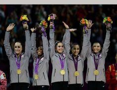 USA gymnasts Jordyn Weiber (from left), Gabrielle Douglas, McKayla Maroney, Alexandra Raisman and Jordyn Weiber celebrate with their gold medals during the national anthem after the women's team gymnastics final during the London 2012 Olympic Games at North Greenwich Arena.
