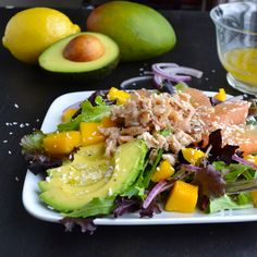 Tropical Crab Salad - mixed greens topped with grapefruit, mango, avocado and crab topped with a citrusy coconut-lemon vinaigrette. | @tasteLUVnourish