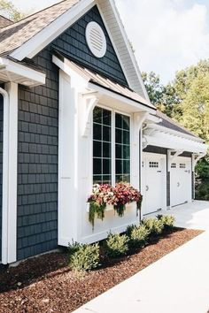 Lake House Exterior Street Side 2019 Lake House Exterior Dark grey charcoal vinyl shake siding with white trim pergola window boxes and corbel details. The post Lake House Exterior Street Side 2019 appeared first on House ideas. House Paint Exterior, Exterior House Colors, Exterior Design, Exterior Windows, Exterior Siding, House Siding, Grey Exterior, Corbels Exterior, Exterior Remodel