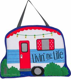 Evergreen Enterprises Felt Door Hanger Livin the Life RV Camper MPN: 2DHF1058 CONDITION: New SIZE: 0.25 x 20 x 15.5 inches MATERIAL: polyester Felt Great way to decorate your front door or gate. Chang