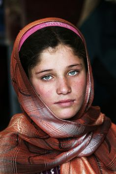 sometimes when you look in a child's eyes you know they have seen too much of life.  Afghan Orphan