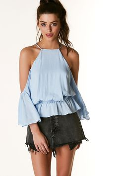 Flirty cold shoulder blouse with cropped bell sleeves. Comfortable elastic band with ruffle style trim finish. Cut out back and ties for closure.