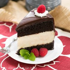 Moist buttermilk chocolate cake filled with a dreamy cheesecake and iced with fudge sauce