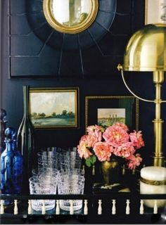 pink flowers...love the super dark paint and gold accents, especially the tiny art pieces and mirror!