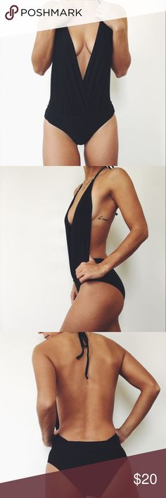 Black deep v one piece This sexy black one piece is in perfect condition and was worn just once for a photoshoot. Purchased from forever 21. Can double as a bodysuit! Forever 21 Swim One Pieces