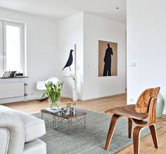 This classically Scandinavian apartment in Malmo, Sweden is for sale and has been styled with a range of Eames and Hans Wegner pieces to produce a light, airy and attractive home with beautiful water views.
