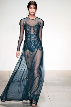 Marios Schwab. I love this rock n' roll lady of the lake look. The blue is deep enough to make it red carpet appropriate but light enough to give the dress an electric cool. The round neck allows the cutout bodice to get the attention it deserves and the combination cap/long sheer sleeves gives the dress a formal but modern edge.