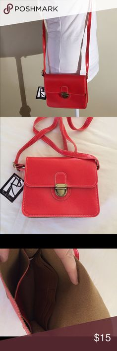 """Nicole Rico Tangerine Crossbody Bag NWT - Hard to describe the color, husband thought it was red when he purchased it for me!  Measures 6.5""""H x 7.5""""W x 2""""D with an adjustable shoulder strap drop of 25"""".  Tongue lock closure. Inside compartment has two slip pockets and four credit card slots. Nicole Rucci Bags Crossbody Bags"""