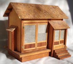 """Japanese Doll House by Russell Mcrae Detailed traditional Japanese style doll house based on plans from vintage children's book, Miss Happiness and Miss Flower. Features cherry and birch plywood, with sliding doors leading to interior. Dimensions  24"""" L x 18"""" W x 21 1/4"""" H"""