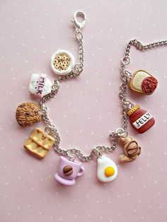 Food charm bracelet jewelry created from polymer clay. With delicious sweets. Th… - DIY Jewelry Simple Ideen Polymer Clay Kawaii, Polymer Clay Charms, Polymer Clay Jewelry, Clay Beads, Halloween Schmuck, Halloween Jewelry, Kawaii Jewelry, Cute Jewelry, Kids Earrings