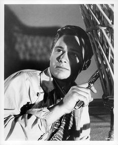 Brandon deWilde holding gun in a scene from the film 'All Fall Down' 1962