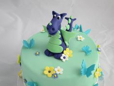 One of two cakes I did for a two part dragon themed baby shower. Figure modeled from 50/50 fondant and gum paste.
