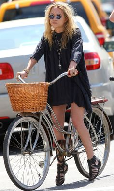 Mary-Kate Olsen goes for a bike ride in round sunglasses, a t-shirt dress & gladiator sunglasses #style #fashion #olsentwins