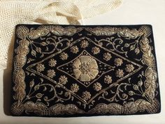 Gorgeous authentic vintage Indian clutch in a black velvet, with elaborate gold metallic (Zardozi) embroidery. From the 1930s/1940s. All done by hand, metallic gold threads are used to create an ornate floral design on black velvet. The workmanship of the