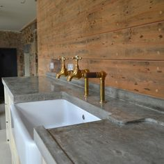 Polished concrete countertops, Farm Sink and a Nifty Faucet!