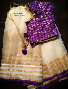 Pretty white and gold saree teamed with a statement purple blouse. Indian fashion.