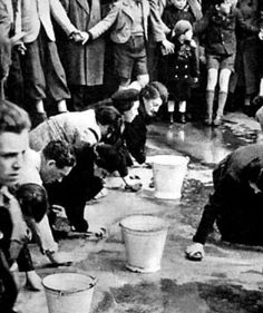 Jews forced to scrub the street of Vienna after the Anschluss (annexation) of Austria, March 1938