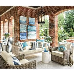 Sunday Porch Swing, available in February 2014.  In Washington Post article, ropes twined loosely around chains looked really cute.