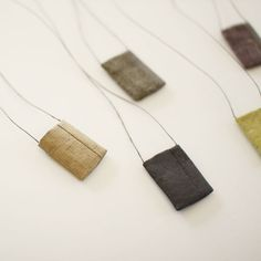 http://uguisustore.com/collections/linen-fabric/products/tadashi-maruyama-obi-textile-necklace