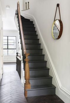 Indoor/Outdoor Living, Brooklyn-Style Sabino – love this! Dark grey stairs against the wooden floors and bannister and white walls