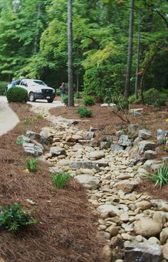 Best landscaping front yard hill dry creek Ideas - All For Garden Dry Riverbed Landscaping, River Rock Landscaping, Driveway Landscaping, Landscaping With Rocks, Landscaping Ideas, House Landscape, Landscape Design, Dry Creek Bed, Outdoor Gardens