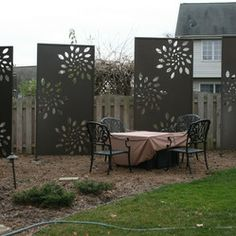 Olson Privacy Metal Panels and Pergola Screen - Custom Laser Cut Steel Privacy Panels in Sunburst Design. Part of extensive landscape projec...