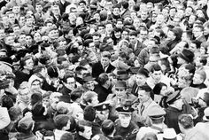 Police and secret service struggle to free President elect John F. Kennedy from a mass of Harvard students in Harvard yard in Cambridge, on January 9, 1961. Kennedy had to take refuge in a dormitory until police could bring a car to get him out.