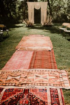 BOHO WEDDING CEREMONY Layering vintage rugs to create an aisle runner leading to a macrame wedding arch is a great way to Cabin Wedding, Chapel Wedding, Boho Wedding, Wedding Ceremony, Wedding Goals, Wedding Isle Runner, Wedding Isles, Unconventional Wedding Dress, Country Wedding Dresses