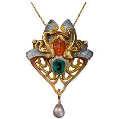 Philippe Wolfers Nixe Enamel Pearl Emerald Diamond Gold Pendant | From a unique collection of vintage drop necklaces at https://www.1stdibs.com/jewelry/necklaces/drop-necklaces/