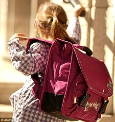 Heavy school bags can weigh double those from 10 years ago, leading to a wave of child back pain problems