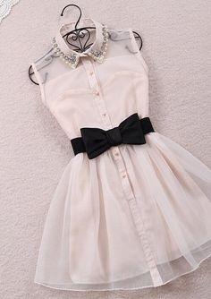 .I really like the beading on the dress. I'm not sure how I feel about the black bow, but I like the dress overall.